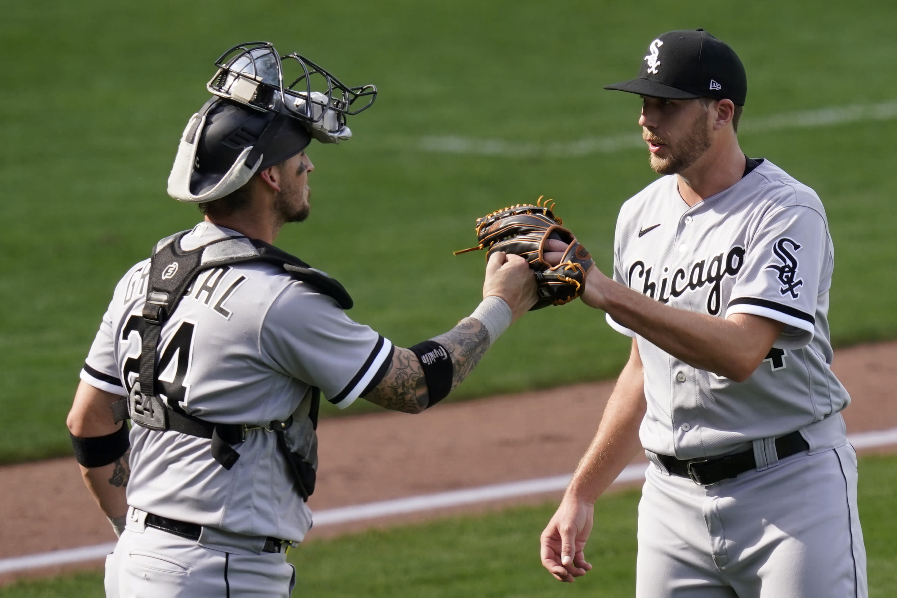 Chicago White Sox pitcher Alex McRae, right, and catcher Yasmani Grandal (24) celebrate following a baseball game against the Kansas City Royals at Kauffman Stadium in Kansas City, Mo., Sunday, Sept. 6, 2020. The Chicago White Sox defeated the Kansas City Royals 8-2. (AP Photo/Orlin Wagner)