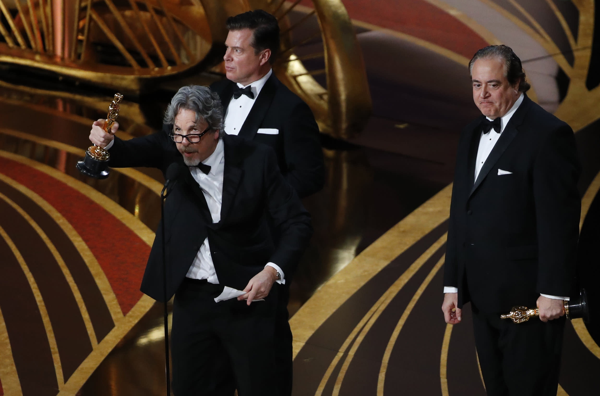"""91st Academy Awards - Oscars Show - Hollywood, Los Angeles, California, U.S., February 24, 2019.  Nick Vallelonga, Brian Currie and Peter Farrelly accept the Best Original Screenplay award for """"Green Book"""". REUTERS/Mike Blake"""