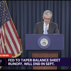 Fed holds rates steady, signals no rate hike this year