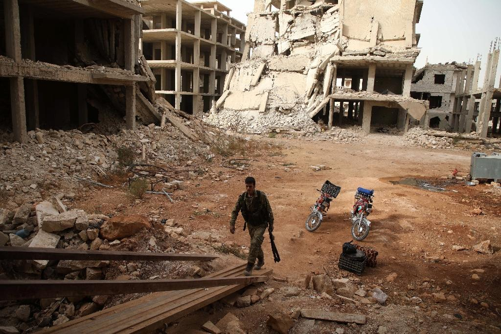 Around 360,000 people have been killed in the Syrian conflict since 2011 (AFP Photo/Aaref WATAD)