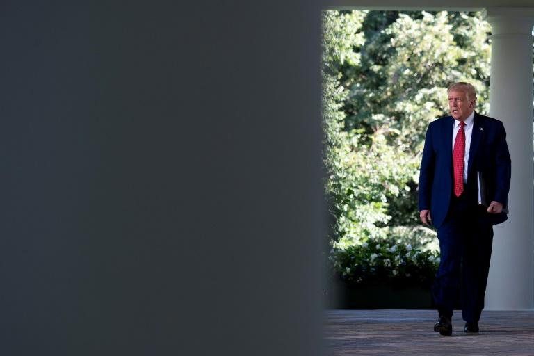 US President Donald Trump arrives to deliver a press conference in the Rose Garden of the White House in Washington, DC, US. (AFP Photo/JIM WATSON)