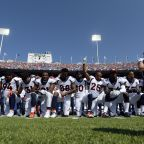 More Than 200 NFL Players Kneel During Anthem in Defiance of President Trump