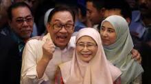 Malaysia's Anwar walks free after royal pardon, meets Mahathir