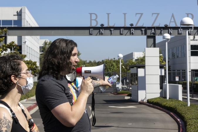 Irvine, CA - July 28: Several hundred Activision Blizzard employees stage a walkout which they say is in a response from company leadership to a lawsuit highlighting alleged harassment, inequality, and more within the company outside the gate at Activision Blizzard headquarters on Wednesday, July 28, 2021 in Irvine, CA. (Allen J. Schaben / Los Angeles Times via Getty Images)