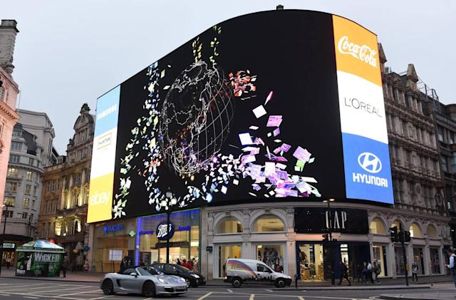 Piccadilly Circus' billboard is alight once more, and it's watching