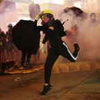 Hong Kong activist stabbed as thousands of protesters clash with police officers during chaotic march