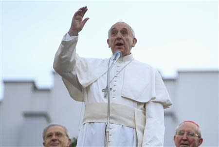 Pope Francis talks to the faithful at the end of a visit to parish San Gregorio Magno in Rome