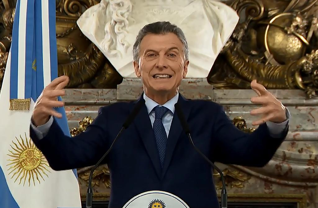 Screen grab from an Argentine government video showing President Mauricio Macri delivering a nationally televised message to announce austerity measures, including the elimination of some government ministries and imposition of new taxes on exports to reduce budget deficits and stabilize the economy (AFP Photo/HO)