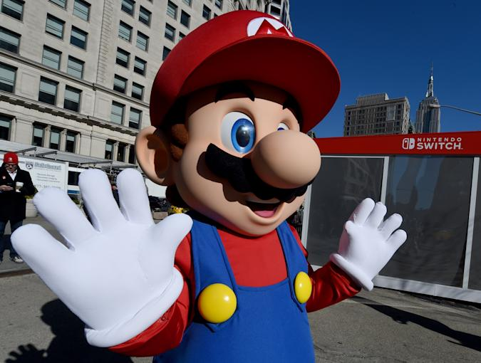 Mario from Super Mario Bros. poses for pictures as the Nintendo Switch is unveiled at  a pop-up Living room in Madison Square Park in New York on March 3, 2017. Nintendo Switch is a first-of-its-kind video game system where you can play at home and take it on-the-go. / AFP PHOTO / TIMOTHY A. CLARY        (Photo credit should read TIMOTHY A. CLARY/AFP/Getty Images)