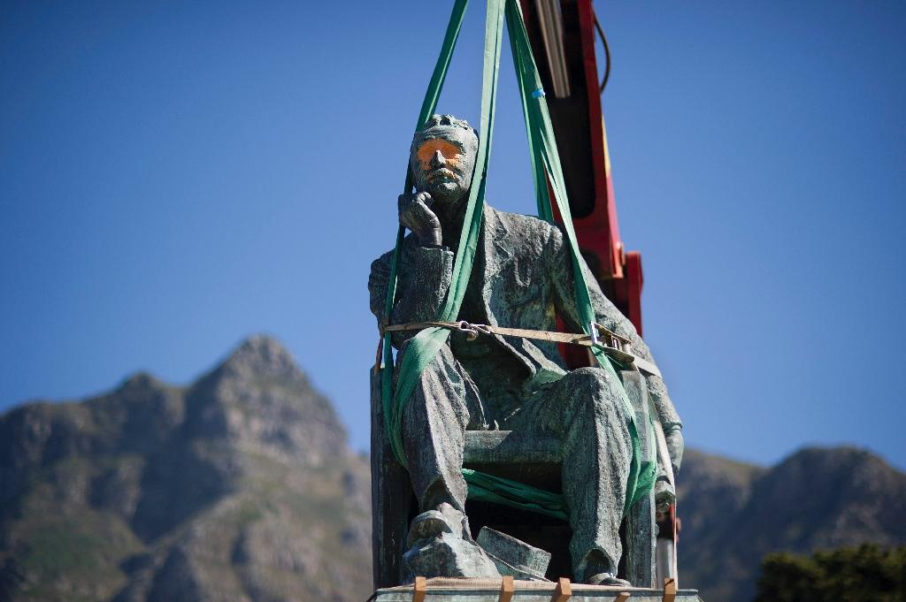South Africa's University of Cape Town voted on April 8 to remove a statue of British colonialist Cecil Rhodes after a month of student protests against a perceived symbol of historical white oppression (AFP Photo/Rodger Bosch)