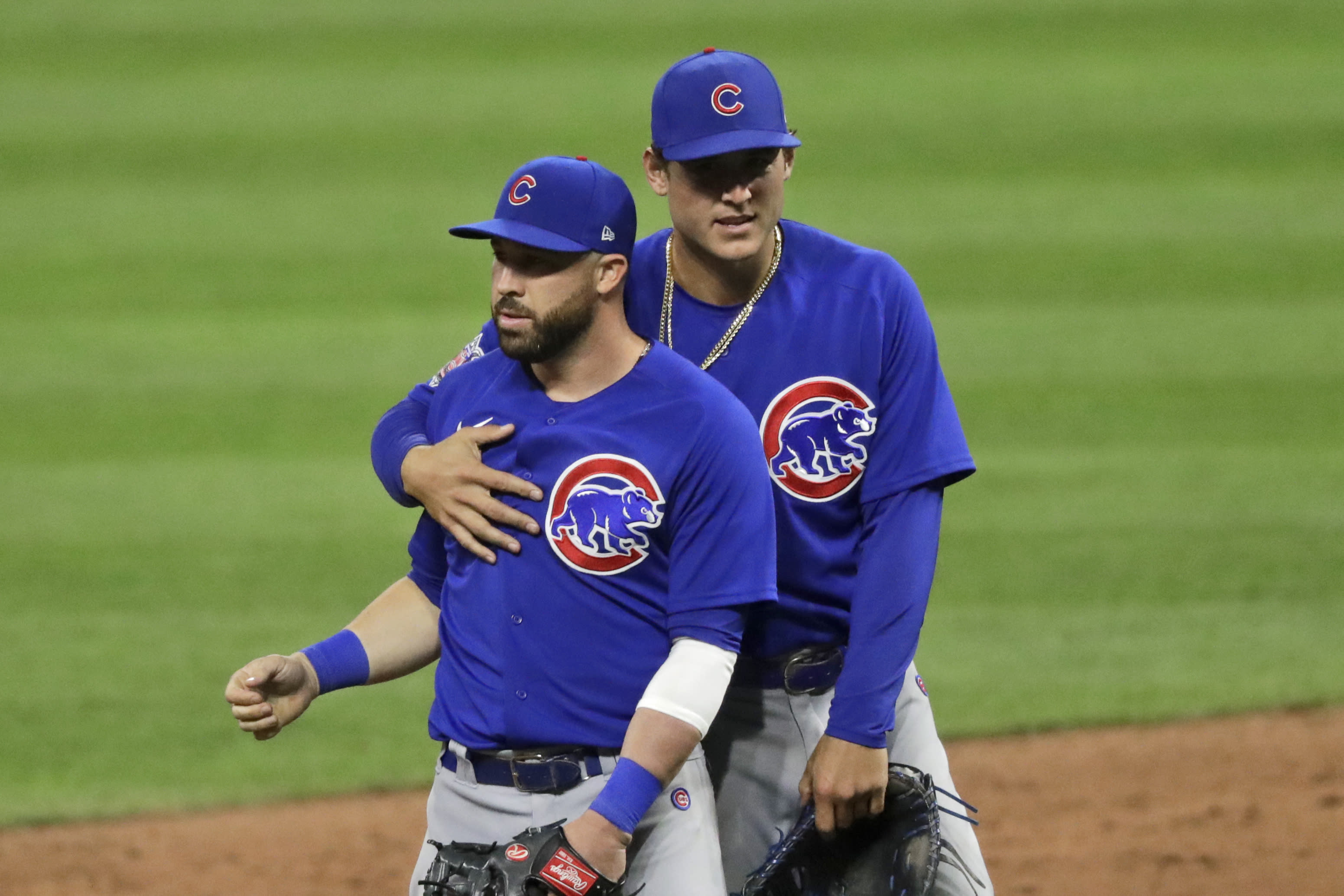 Chicago Cubs' Anthony Rizzo, right, and Jason Kipnis hug after the Cubs defeated the Cleveland Indians 7-2 in a baseball game, Wednesday, Aug. 12, 2020, in Cleveland. (AP Photo/Tony Dejak)