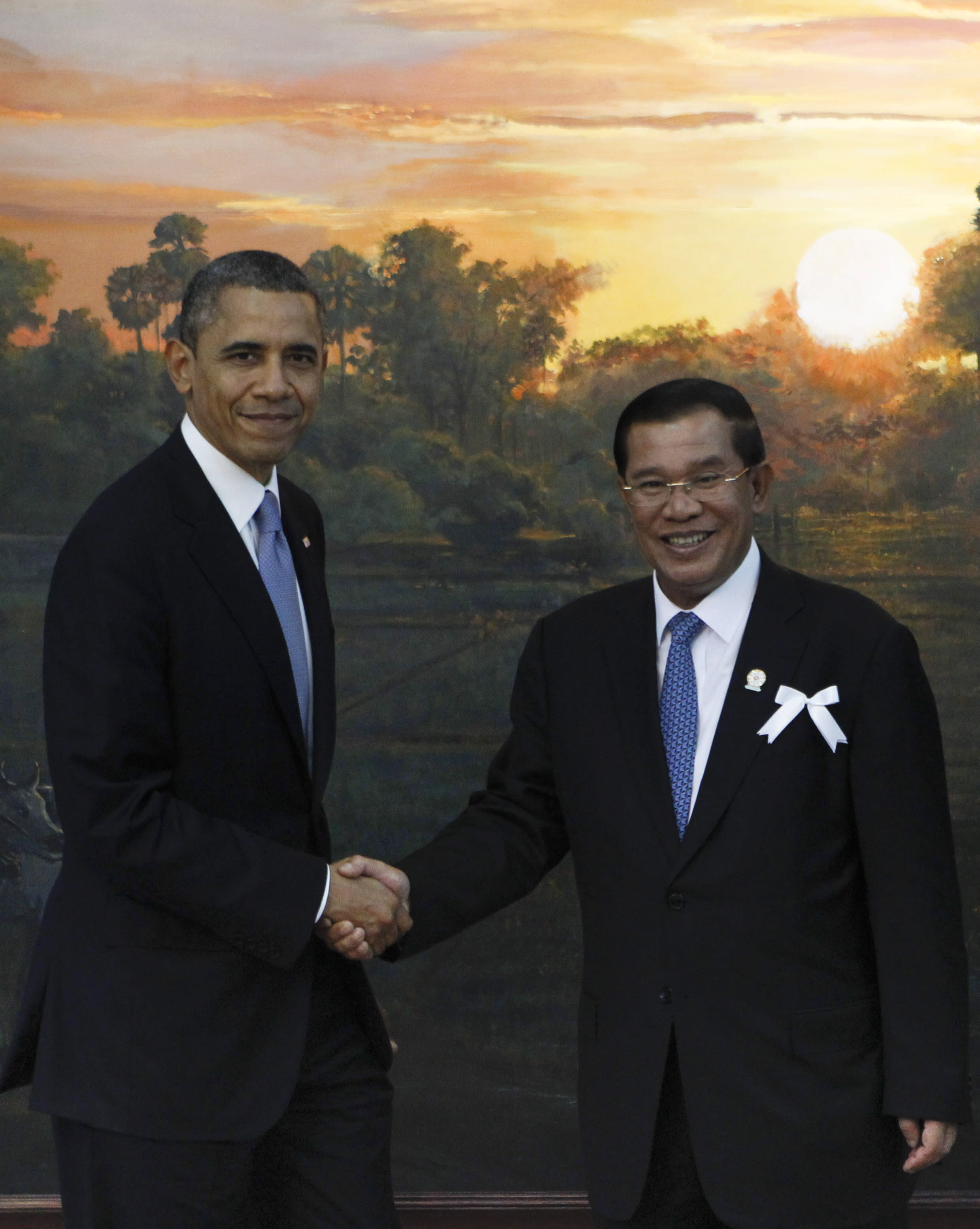 U.S. President Barack Obama, left, poses with Cambodia's Prime Minister Hun Sen for photographers before the ASEAN-U.S. leaders meeting in Phnom Penh, Cambodia, Monday, Nov. 19, 2012. (AP Photo/Vincent Thian)
