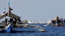 Philippines protests China's 'illicit' warnings, coast guard conduct