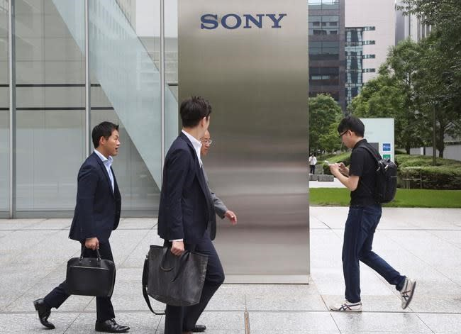 Sony's profit dip, sticks to forecast for year