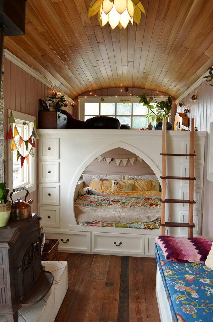 <p>The couple maximizes available space through this loft, Mira Thompson says. They can sit and lounge on the top part, and sleep tucked into the bottom nook, where they co-sleep with their daughter, Carys.<br></p>