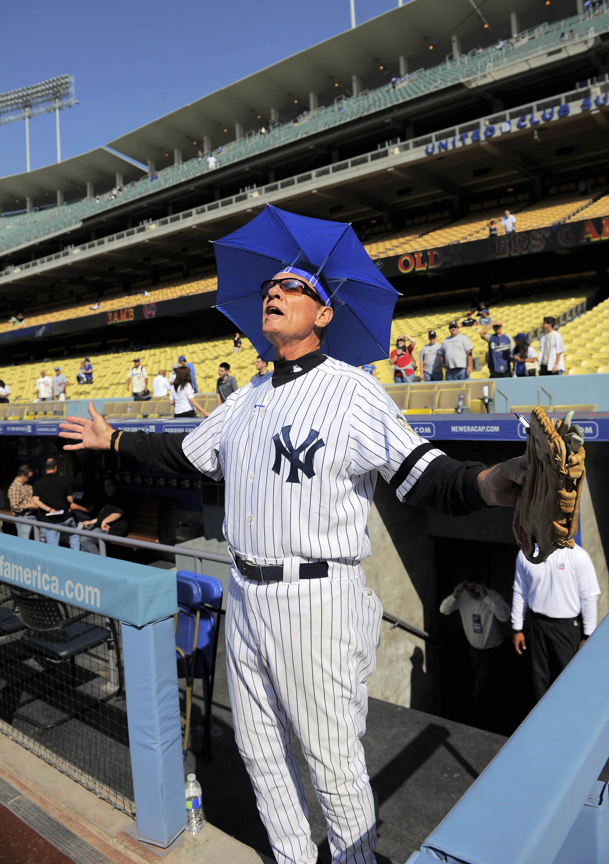 FILE- In this June 8, 2013, file photo, Jay Johnstone walks out of the dugout during batting practice prior to the Old-Timers baseball game in Los Angeles. Johnstone, who won World Series championships as a versatile outfielder with the New York Yankees and Los Angeles Dodgers while being baseball's merry prankster, died Saturday, Sept. 26, of complications from COVID-19 at a nursing home in Granada Hills, Calif., his daughter Mary Jayne Sarah Johnstone said Monday, Sept. 28, 2020. He was 74. He also from dementia in recent years, his daughter said. (AP Photo/Mark J. Terrill, File)