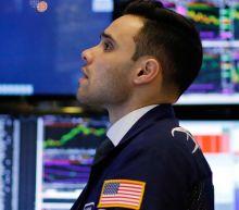 Nasdaq hits 7000 for first time as Wall Street awaits tax bill vote