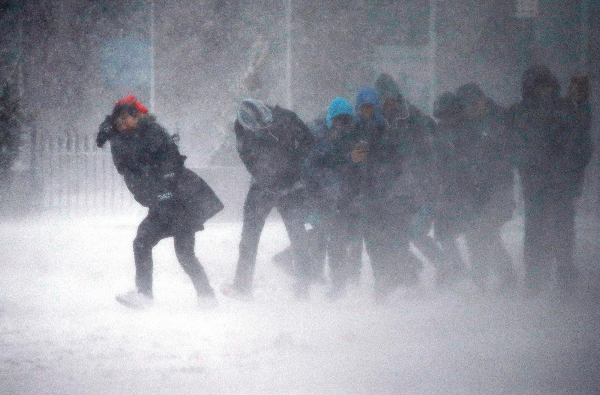 <p>People struggle to walk in the blowing snow during a winter storm Tuesday, March 14, 2017, in Boston. (AP Photo/Michael Dwyer) </p>