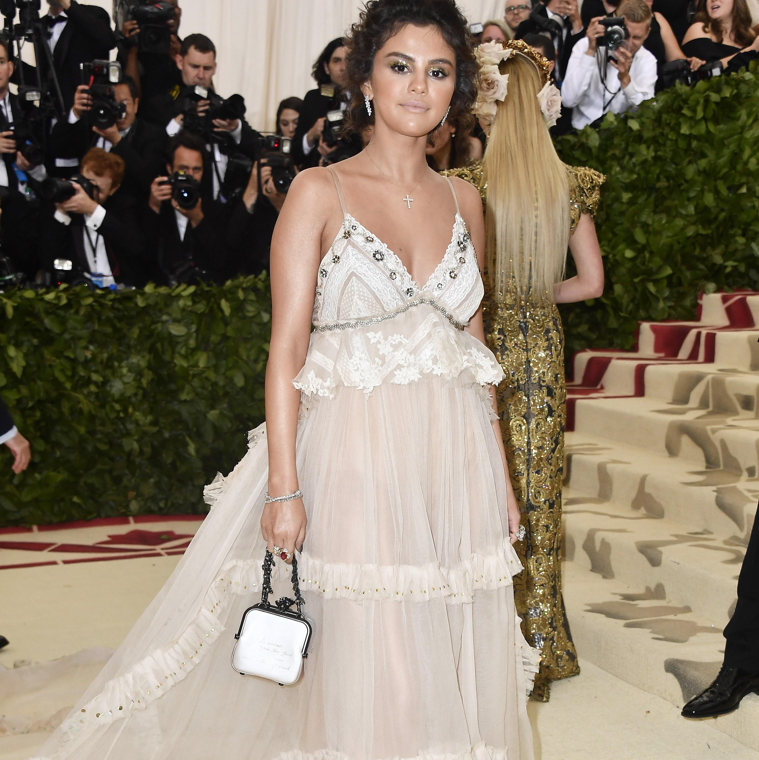 6581cc5ab74 Selena Gomez Hid a Secret Message on Her Coach Bag at the Met Gala 2018