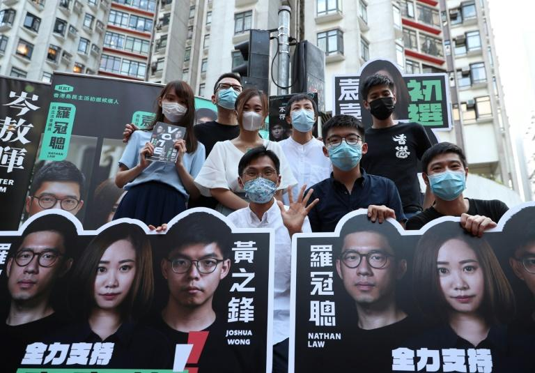 Pro-democracy campaigners pose during the July 2020 primary election in Hong Kong that has irritated Beijing (AFP Photo/May JAMES)