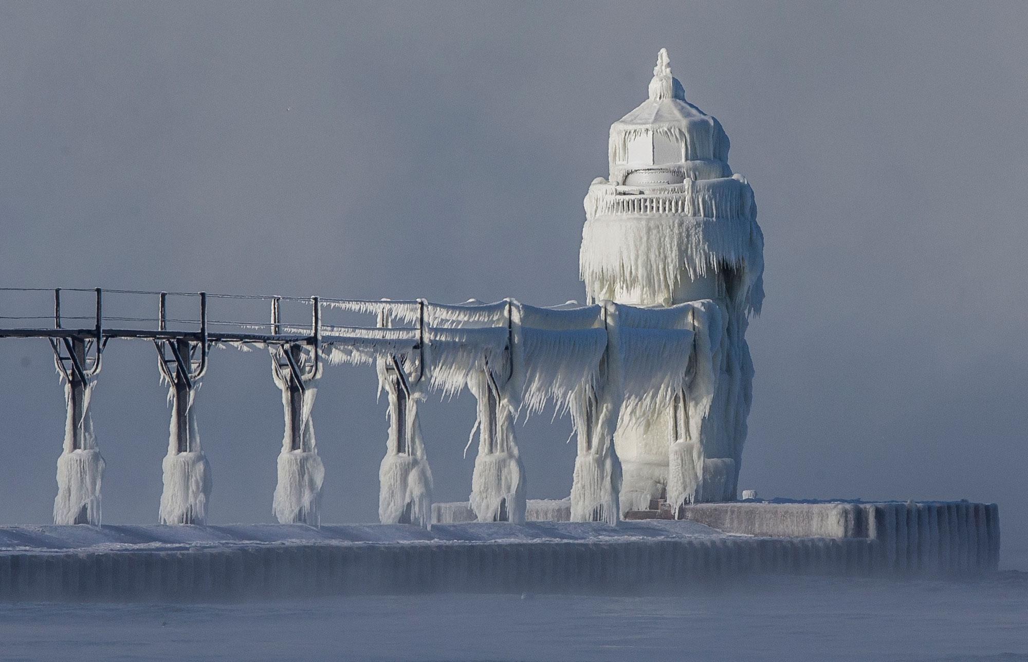 <p>Extreme cold conditions cause ice accretions to cover the St. Joseph lighthouse and pier, on the southeastern shoreline of Lake Michigan, on Monday, Dec. 19, 2016, in St. Joseph, Mich. (Photo: Robert Franklin/South Bend Tribune via AP) </p>