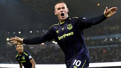 Rooney makes history as Everton draws City
