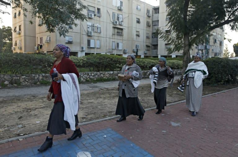 Women of the Ethiopian Jewish community walk in the central Israeli city of Rehovot (AFP Photo/MENAHEM KAHANA)