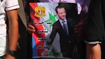Syrians in Lebanon return home to vote as others protest
