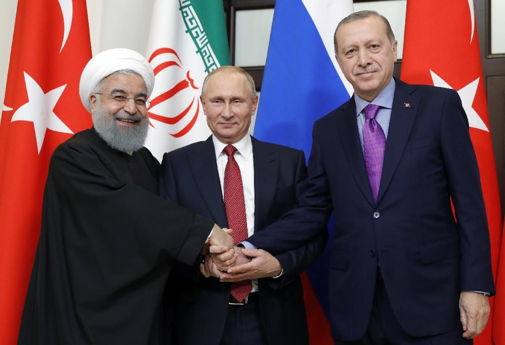 Russian President Vladimir Putin flanked by Turkish President Recep Tayyip Erdogan (r) and Iranian President Hassan Rouhani pose during a trilateral meeting on Syria in Sochi last November (AFP Photo/Mikhail METZEL)