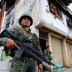 Philippine president declares Marawi liberated as battle goes on