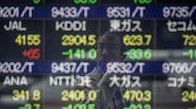 Indexes in Asia close in the green as markets digest corporate earnings, Fed decision
