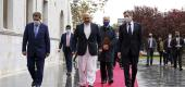 Secretary of State Antony Blinken, center right, walks with Afghanistan's Foreign Minister Mohammad Haneef Atmar, center left, at the presidential palace in Kabul. (AP)