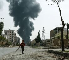 Rebel rocket fire kills 35 in Damascus suburb