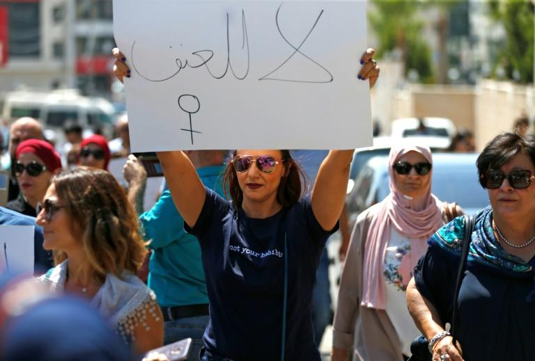 """Palestinian women protest in support of women's rights outside the premier's office in the West Bank city of Ramallah. Arabic slogan on placard reads: """"No to violence"""""""