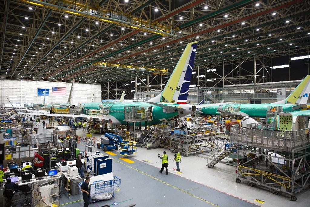 American aviation giant Boeing says a bad batch of parts involved in deploying the wings' leading edge made it into some models of the 737 airplane similar to the ones pictured here (AFP Photo/Jason Redmond)