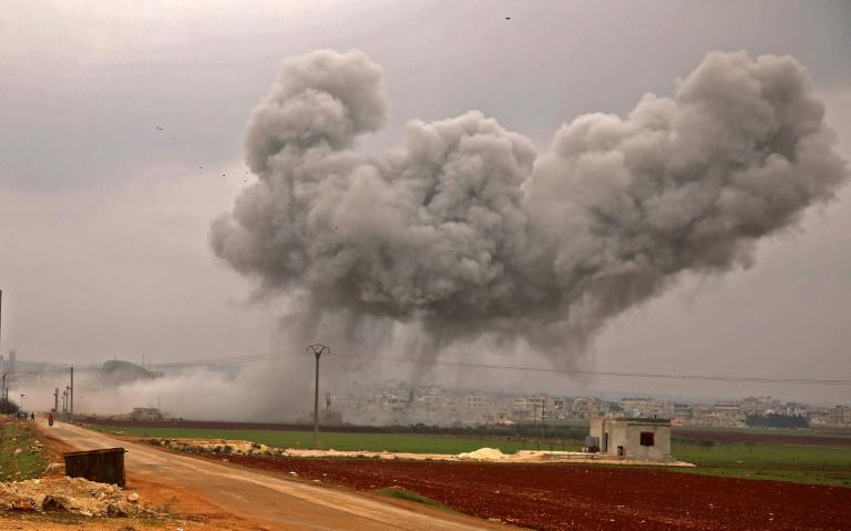 A large plume of smoke billows into the air above the rebel-held town of Atareb as government forces keep up their bombardment (AFP Photo/AAREF WATAD)