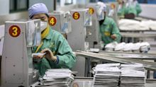 China's March Factory Outlook Jumps as Global Threat Looms