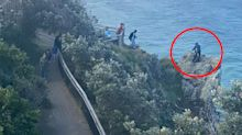 'Definitely stupid': Photo of people standing on cliff edge to 'take selfie' sparks rage