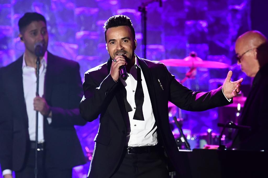 "Puerto Rican Singer Luis Fonsi performs his song ""Despacito"" during the traditional Clive Davis party on the eve of the 60th Annual Grammy Awards on January 28, 2018, where rapper Jay-Z was guest of honor (AFP Photo/Jewel SAMAD)"