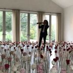 Kanye West hires Kenny G to play for Kim Kardashian in a room full of roses for Valentine's Day