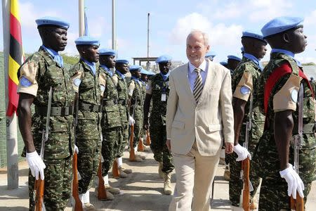 U.N. special representative for Somalia Kay inspects Ugandan peacekeeping troops during a ceremony at Mogadishu airport in Somalia