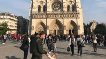 Woman finds dad and daughter in photo she took at Notre Dame moments before devastating fire