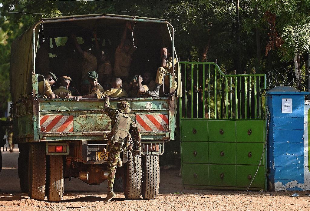 A member of Kenya Defence Forces boards a truck in Garissa on April 3, 2014 (AFP Photo/Carl de Souza)