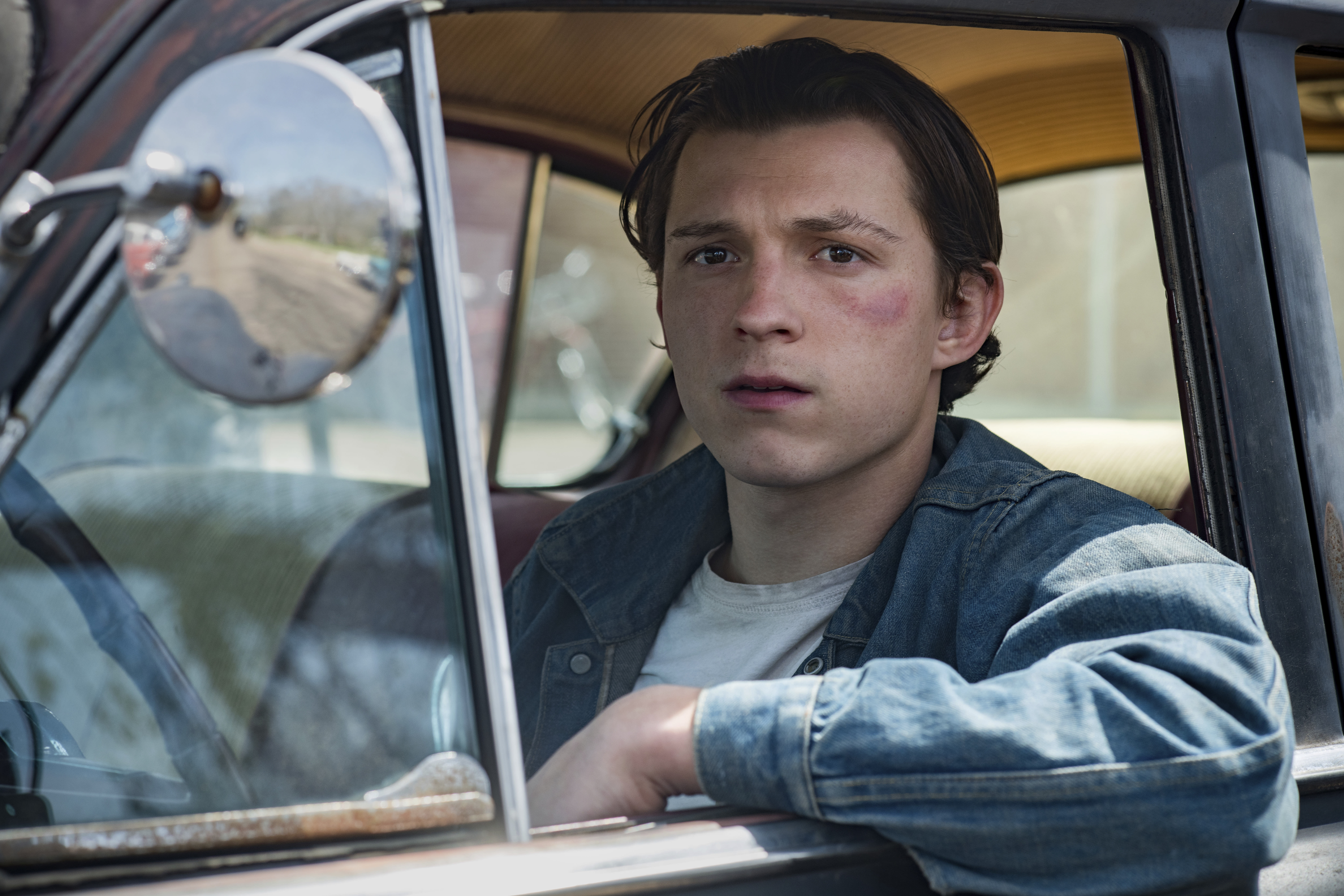 """This image released by Netflix shows Tom Holland in a scene from """"The Devil All The Time."""" (Glen Wilson/Netflix via AP)"""