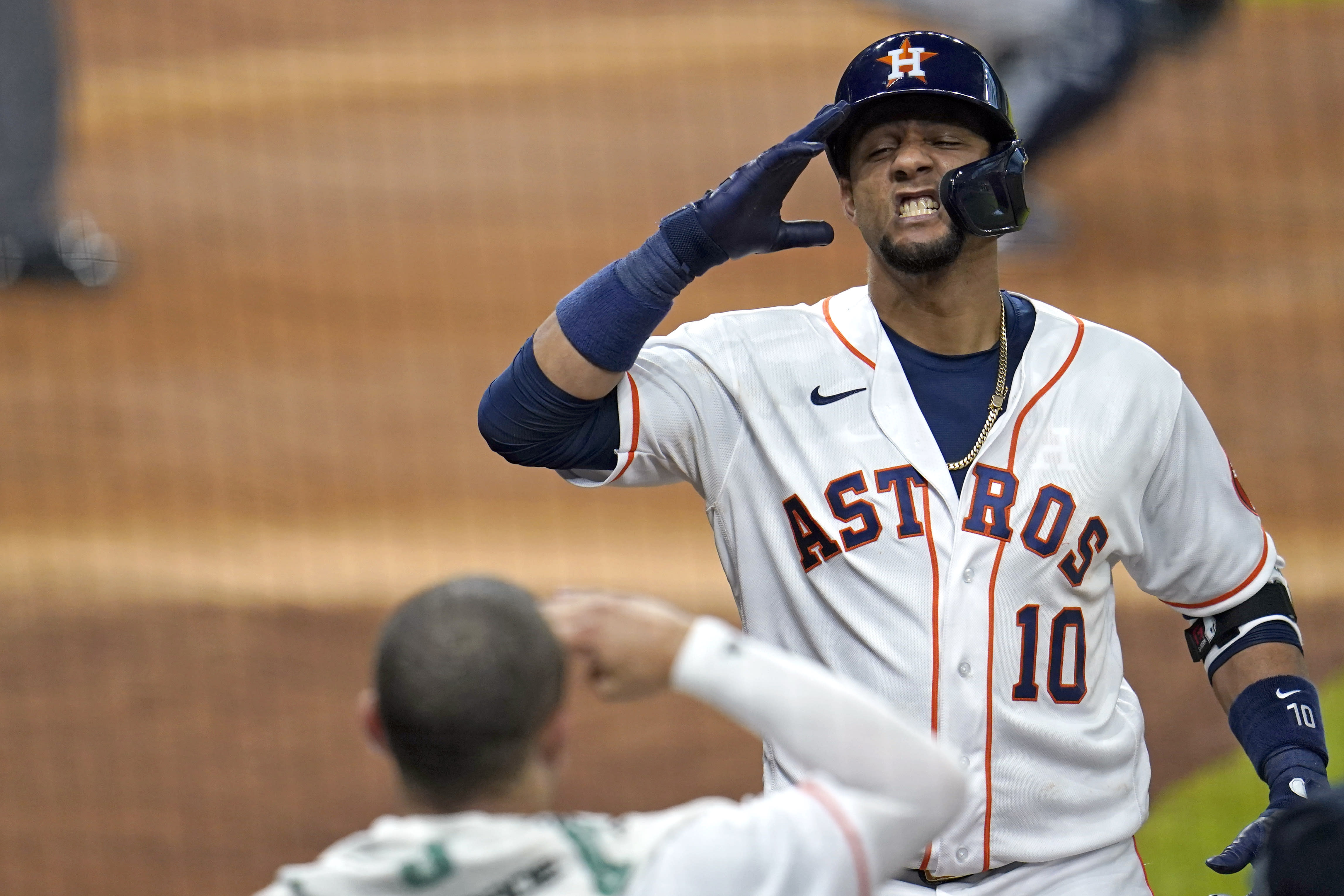 Houston Astros' Yuli Gurriel (10) celebrates with Alex Bregman after hitting a home run against the Seattle Mariners during the fourth inning of a baseball game Saturday, July 25, 2020, in Houston. (AP Photo/David J. Phillip)