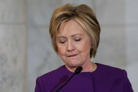 Clinton delivers remarks at a ceremony to unveil a portrait honoring Reid on Capitol Hill in Washington