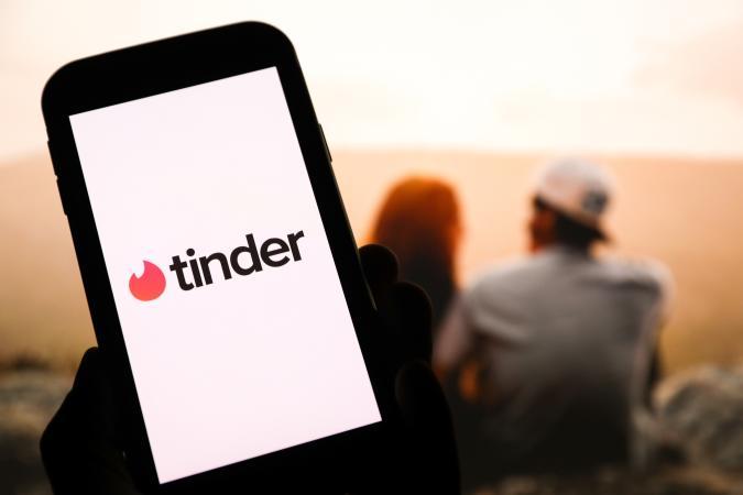 POLAND - 2020/05/04: In this photo illustration a Tinder logo seen displayed on a smartphone. (Photo Illustration by Filip Radwanski/SOPA Images/LightRocket via Getty Images)