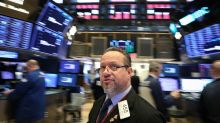 Wall St. trims gains as U.S., China struggle over gaps in trade issues