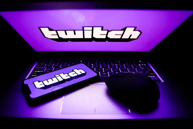 Twitch logos are seen displayed on a phone and a laptop screens in this illustration photo taken in Krakow, Poland on April 30, 2021. (Photo by Jakub Porzycki/NurPhoto via Getty Images)