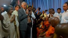 Sri Lanka reinstates ousted PM, begins uneasy truce